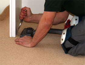 Floor Crazy fitter laying carpet